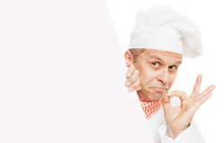 Smiling chef isolated on white. Smiling chef holding info board, isolated on white background stock photography