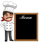 Smiling Chef looking at menu on blackboard Royalty Free Stock Photo