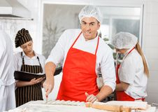 Smiling Chef Preparing Ravioli Pasta With Stock Photography