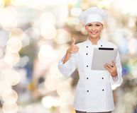 Smiling chef with tablet pc showing thumbs up Royalty Free Stock Photo