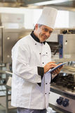 Smiling chef using digital tablet Stock Image