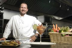 Smiling chef with vegetables and shrimp Stock Photography