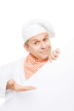 Smiling chef with white board. Smiling chef with info board isolated on white background Stock Image