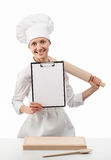 Smiling chef woman cook holding blank clipboard and rolling pin Royalty Free Stock Image