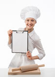Smiling chef woman cook holding blank clipboard Stock Photos
