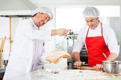 Smiling Chefs Preparing Ravioli Pasta Together In Royalty Free Stock Photo