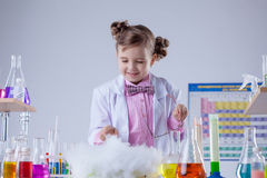 Smiling chemist successfully conducted experiment Stock Photo