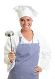 Smiling chief cook with a ladle. Stock Photos