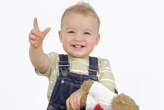 Smiling child. Little girl with her teddy bear. Studio shot Royalty Free Stock Photography