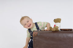 Smiling child. Old suitcase with little child Royalty Free Stock Photo
