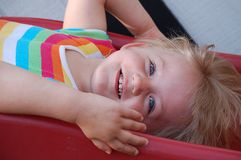 Smiling child. Child lying on his back and smiling Stock Image