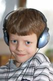 Smiling child. In headphones Royalty Free Stock Images