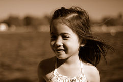 Smiling child. Smiling asian girl at the lake Stock Photography