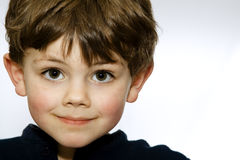 Smiling child. Child smiling on a gray to white background Stock Photos