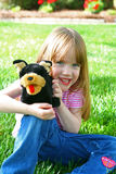 Smiling child. Smiling little girl sitting in the grass Royalty Free Stock Photos