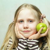 Smiling child and apple Royalty Free Stock Photography