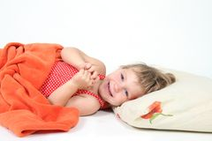 Smiling child in bed over white Royalty Free Stock Photos