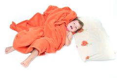 Smiling child in bed over white Royalty Free Stock Photo