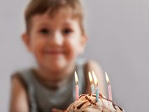 Smiling child with birthday cake candle Stock Images