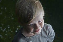 Smiling child blond boy outdoors portrait. Smiling boy outdoors portrait in the garden, outside, summertime Stock Photo
