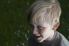 Smiling child blond boy outdoors portrait. Smiling boy outdoors portrait in the garden, outside, summertime Stock Images