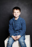 Smiling Child Boy in Blue Sweater Stock Photo