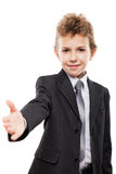 Smiling child boy in business suit gesturing hand greeting or meeting handshake Stock Photo