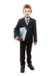 Smiling child boy in business suit holding books Royalty Free Stock Photo
