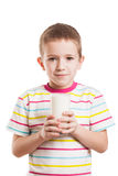 Smiling child boy drinking milk royalty free stock images