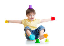 Smiling child boy having fun with color toys. Isolated on white stock photography