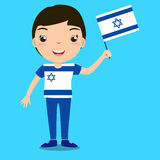 Smiling child, boy, holding a Israel flag isolated on blue backg Royalty Free Stock Photo