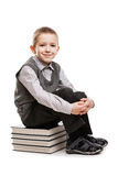 Smiling child boy sitting on reading books Stock Photo