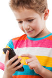 Smiling child boy talking mobile phone or smartphone Stock Photo