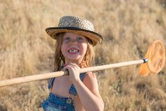 Smiling child with butterfly net stock image