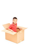 A smiling child in a cardbox Stock Photography