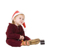 Smiling child in Christmas red hat Stock Photo