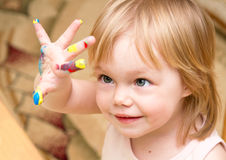 Smiling child with the color hand. Smiling child looks at the color hand Stock Images