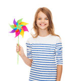 Smiling child with colorful windmill toy Royalty Free Stock Images