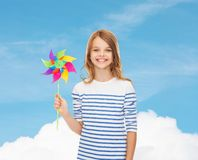 Smiling child with colorful windmill toy Stock Photos