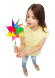 Smiling child with colorful windmill toy Stock Photo