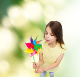 Smiling child with colorful windmill toy Stock Photography