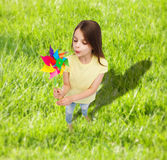 Smiling child with colorful windmill toy Stock Image