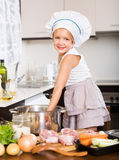 Smiling child cooking soup Stock Photo