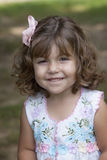Smiling child with curly hair Royalty Free Stock Photography
