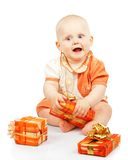 Smiling child develops gift box Stock Image