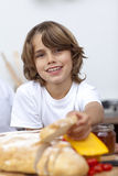 Smiling child eating bread Stock Photo