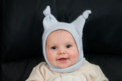 Smiling child with funny hat Stock Image