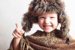 Smiling child in fur Hat.fashion winter style.little funny boy.children emotion Stock Photo