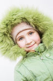 Smiling child in fur hood Royalty Free Stock Images