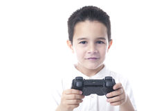 Smiling Child with game controller in their hands. Stock Image